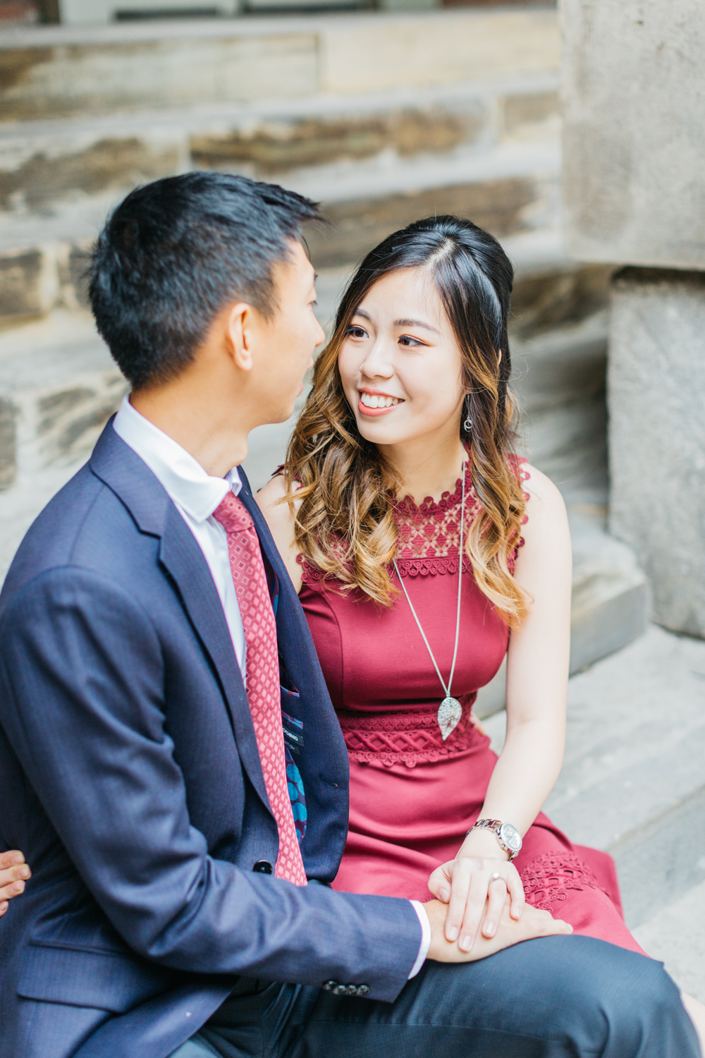 Couple talking on steps at Osgoode Hall
