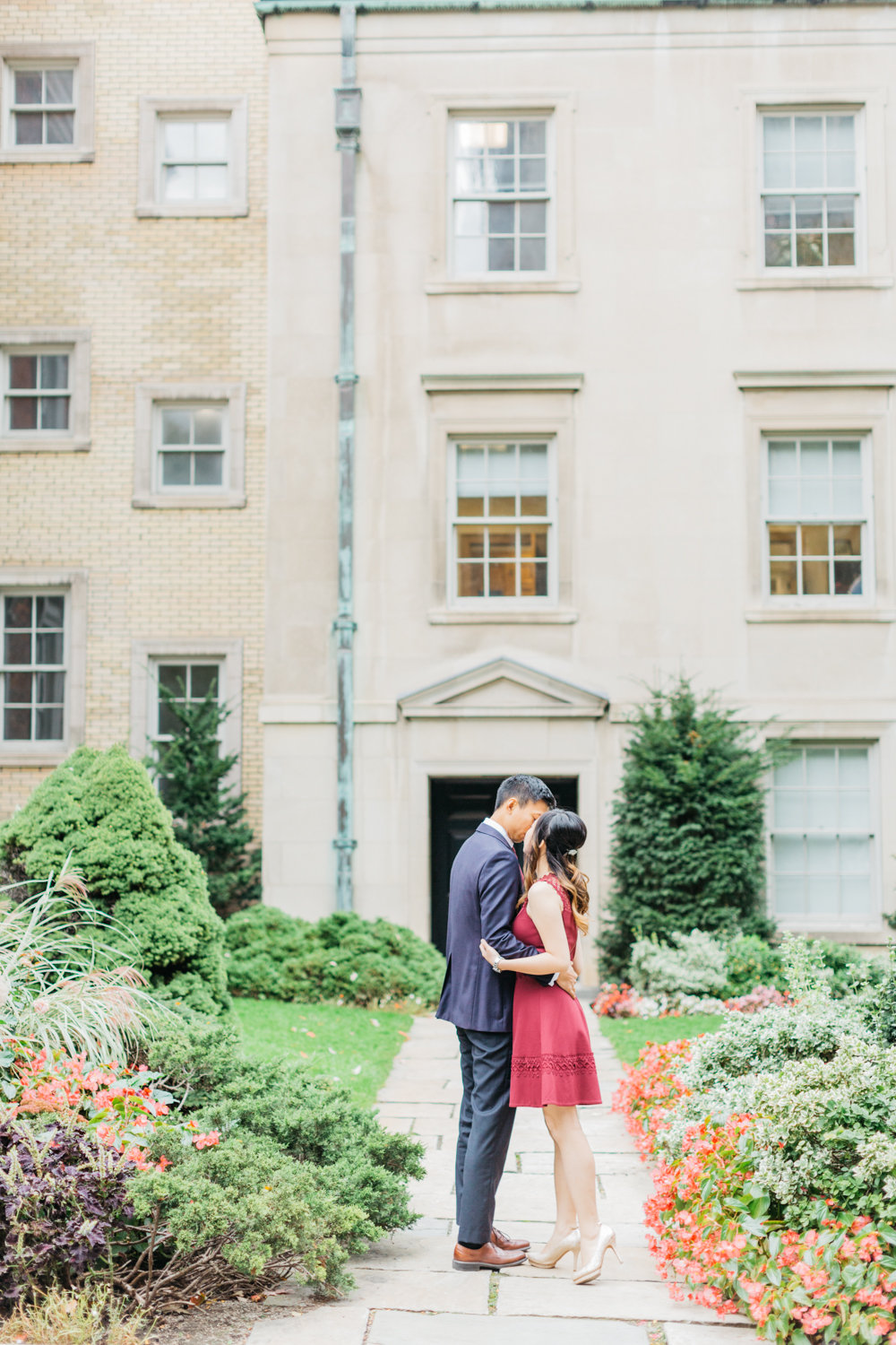 Couple kissing on pathway at Osgoode Hall