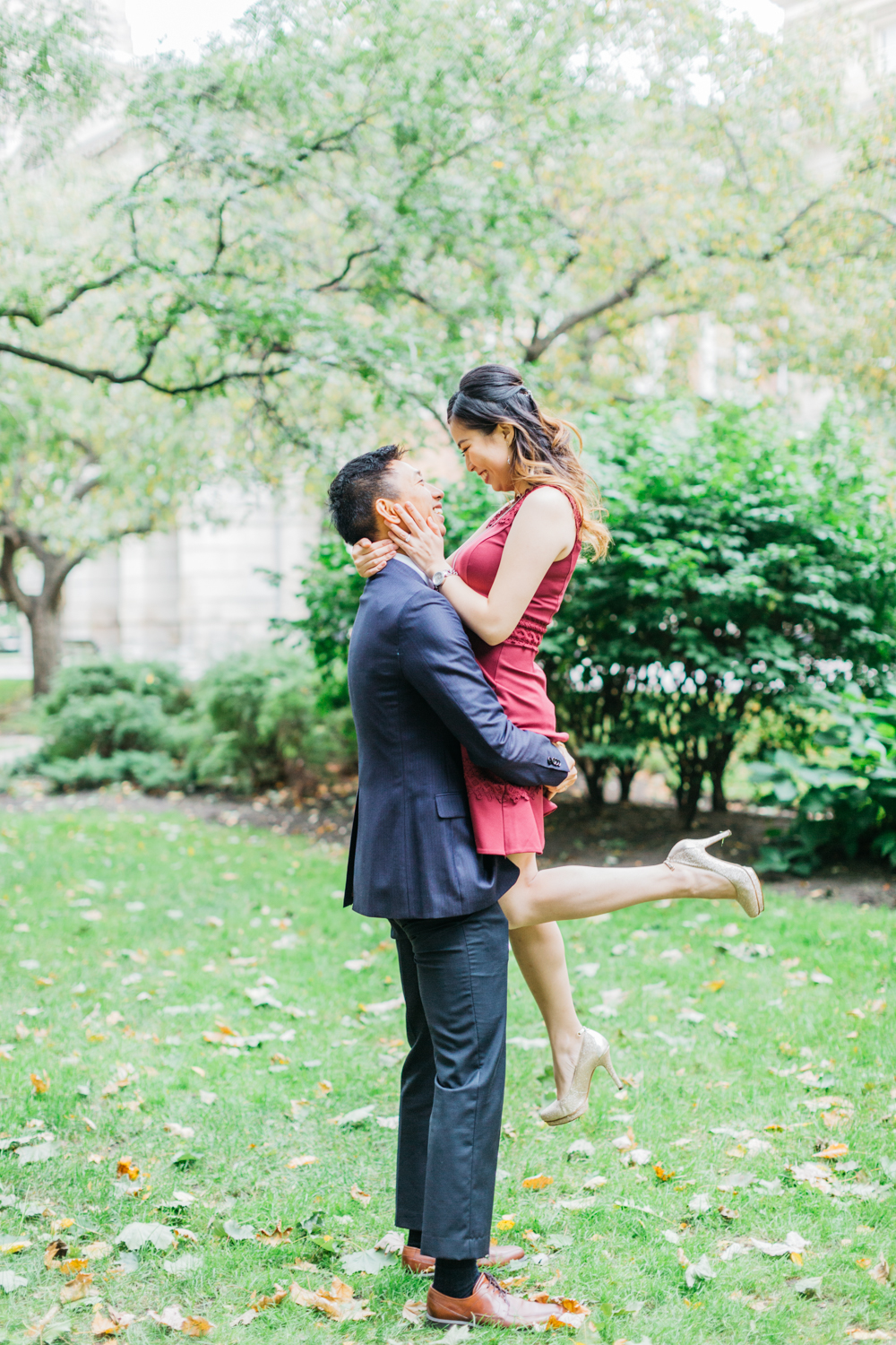 Man lifting fiance in Osgoode Hall