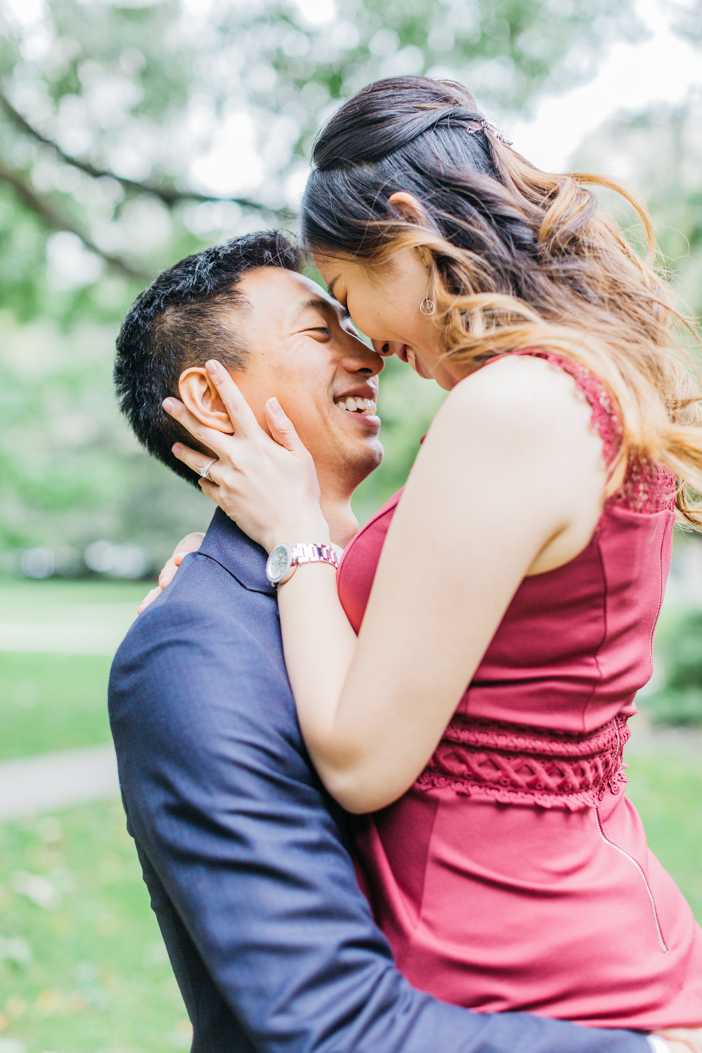 Couple kissing during romantic fall engagement at osgoode hall