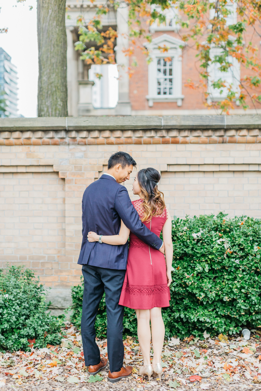 Couple holding each other during engagement at Osgoode Hall
