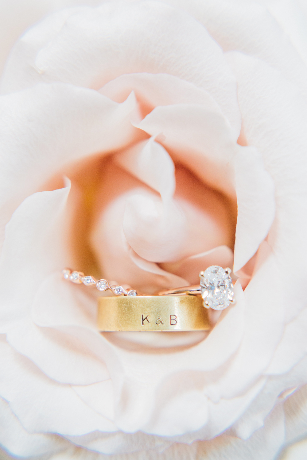 Bride and groom's rings photographed in a flower