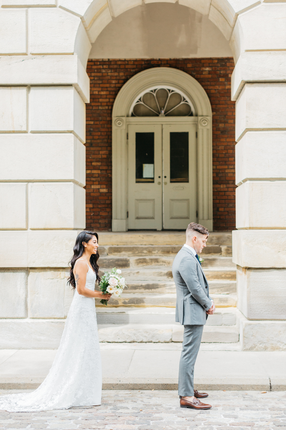Bride and groom's first look at Osgoode Hall