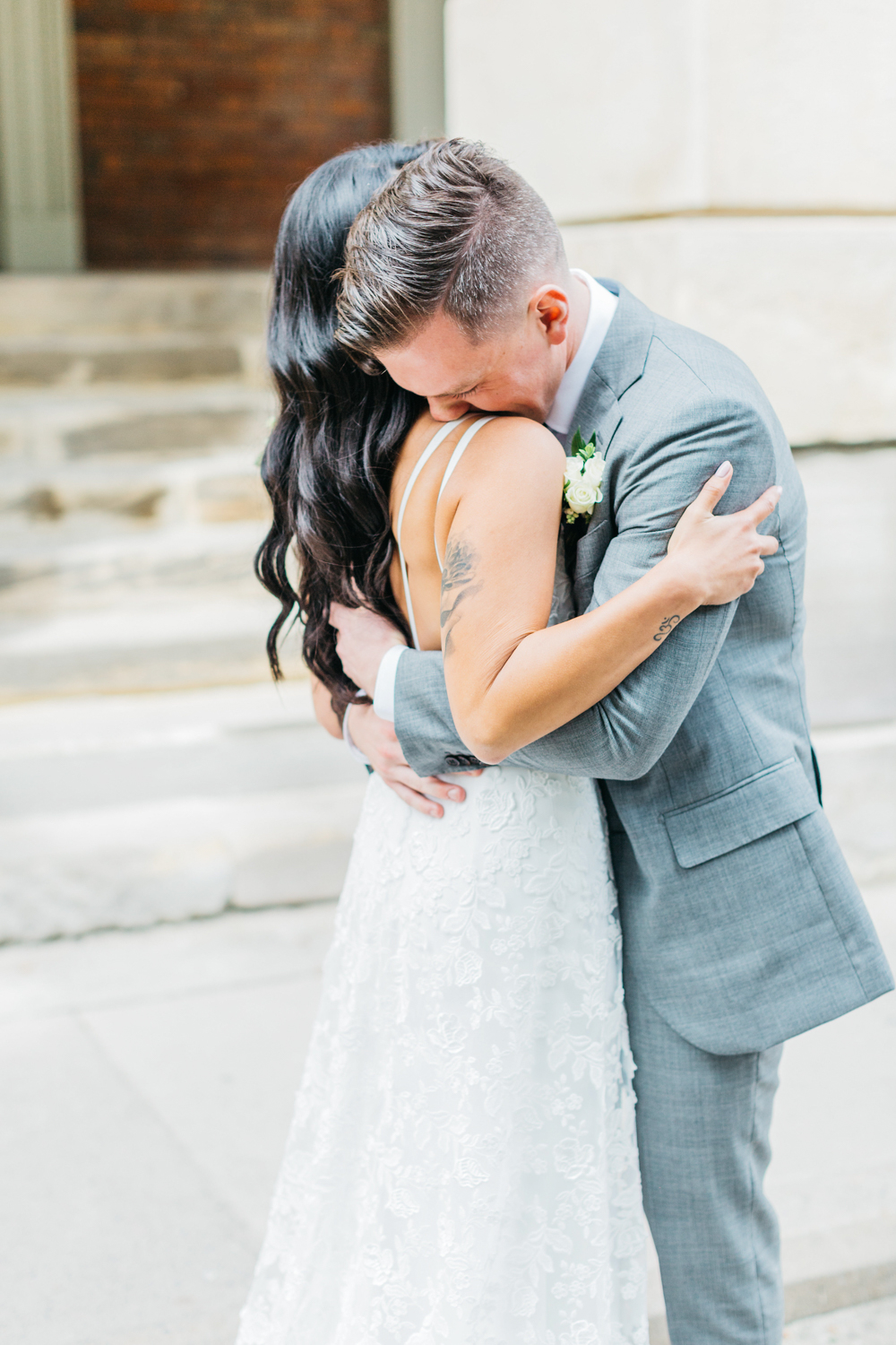 Groom crying seeing bride for first time during first look at Osgoode hall