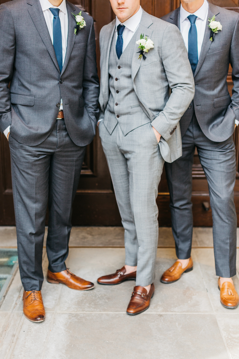Detail shot of groom with groomsmen at Osgoode Hall
