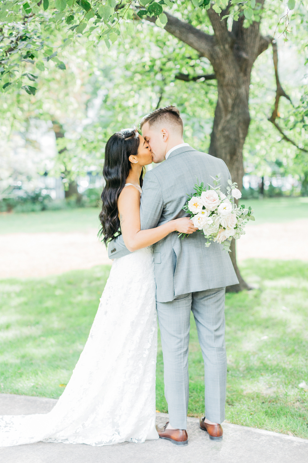 Bride and groom kissing at Osgoode Hall