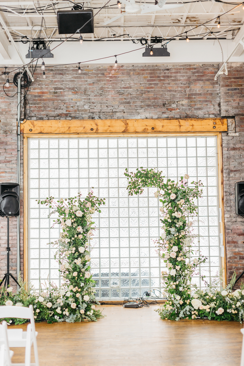 Ceremony background florals by Rikki Marcone Events at The Glass Factory