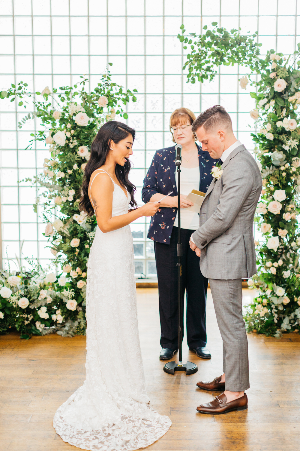 Bride exchanging vows at the Glass Factory