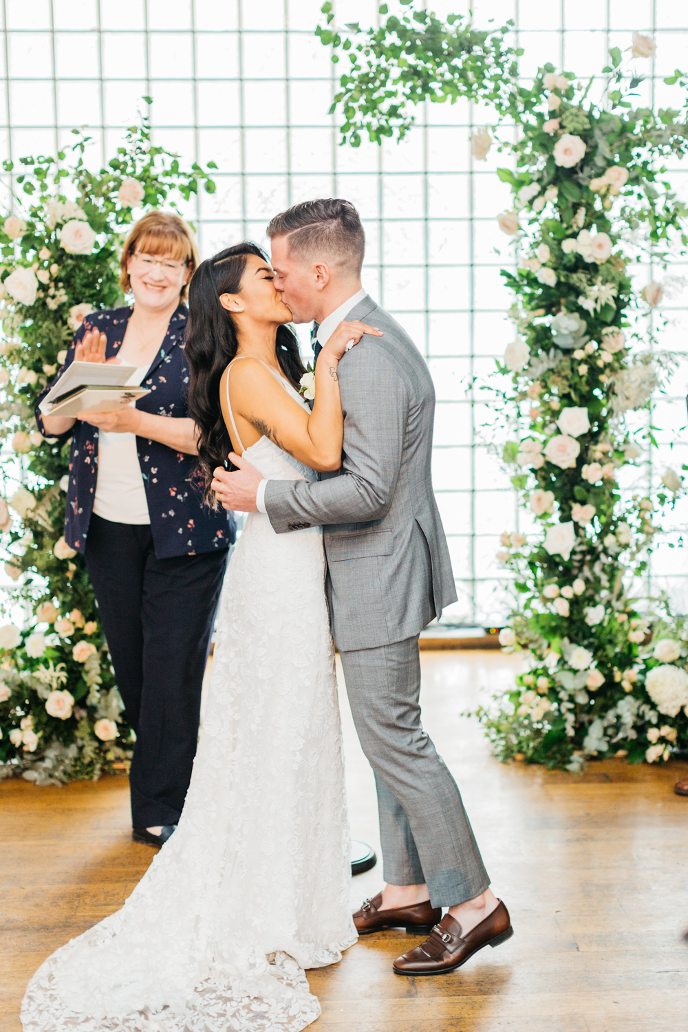Bride and groom's first kiss as a married couple at The Glass Factory