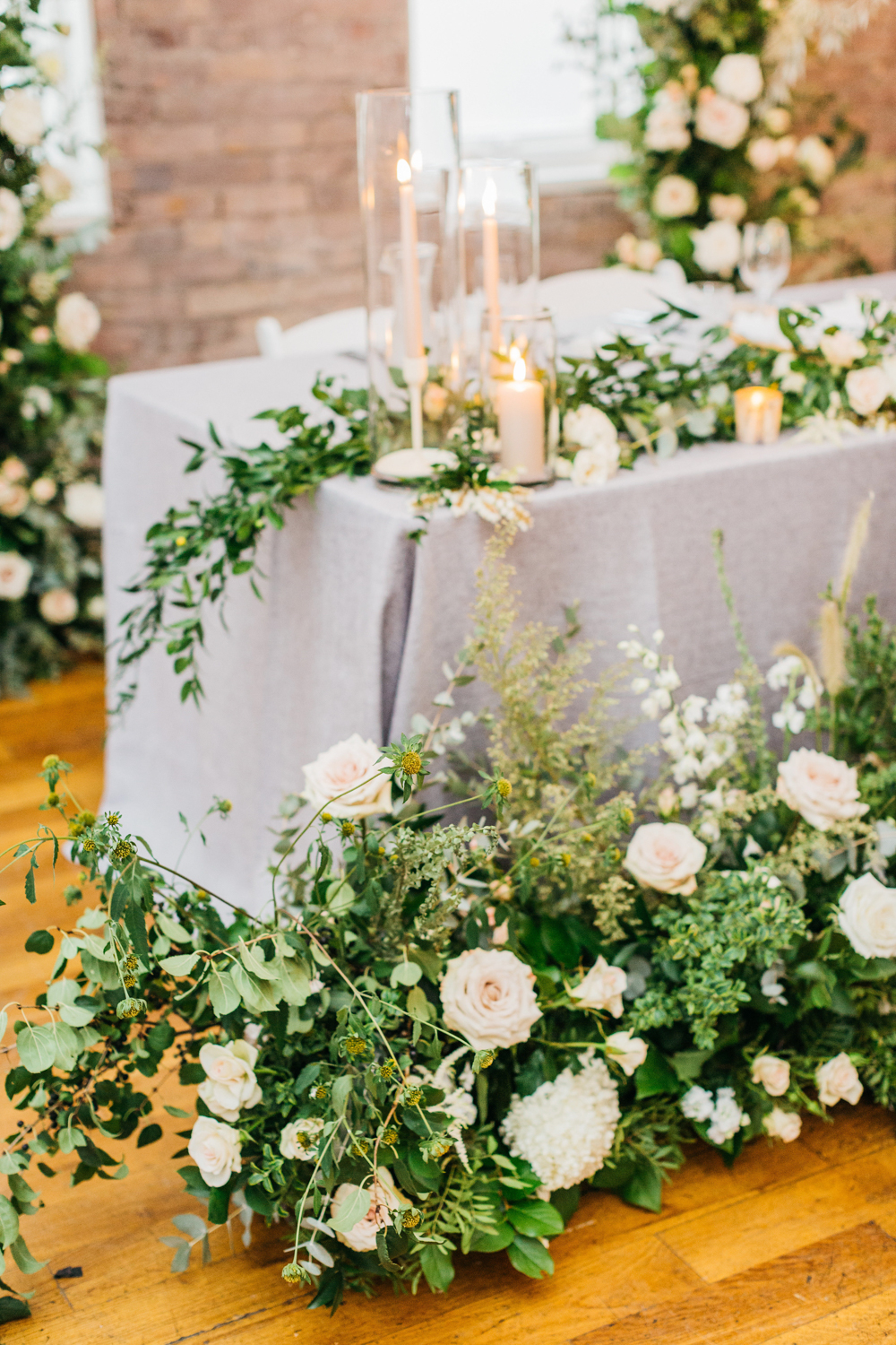 Head table shots of florals at 99 Sudbury The Glass Factory