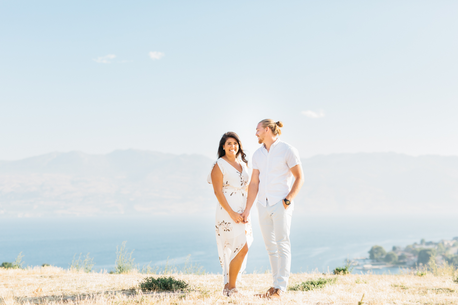 Couple holding hands at Quails' Gate Estate & Winery in Kelowna B.C