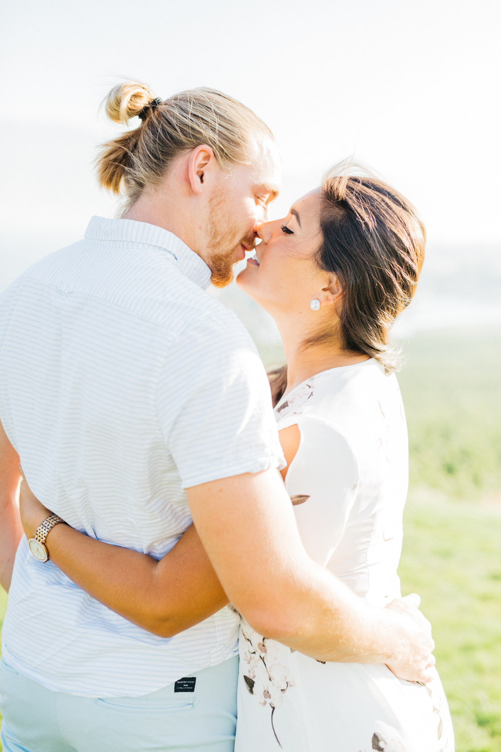 Couple going in for a kiss at Quails' Gate Estate & Winery
