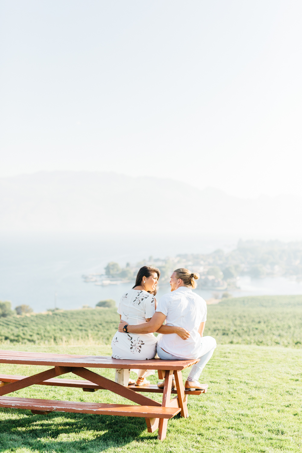 Couple taking on bench at Quails' Gate Estate & Winery