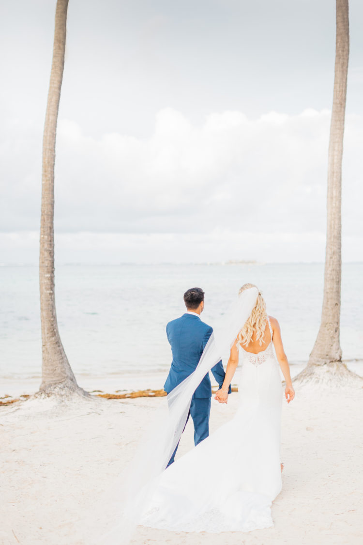 couple walking on beach during destination weddding