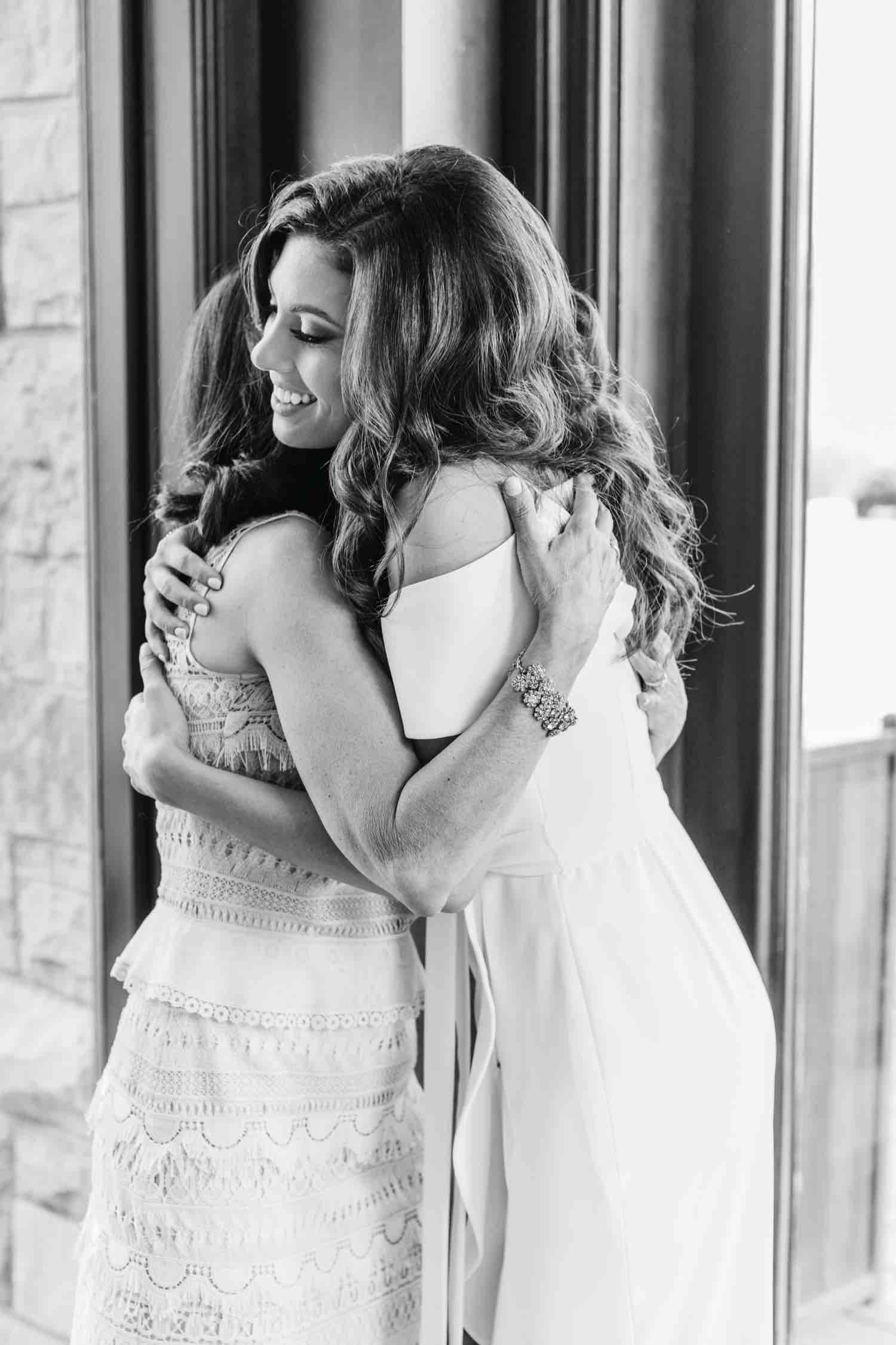Bride hugging her mom at Eagles Nest Golf Club Bridal Shower