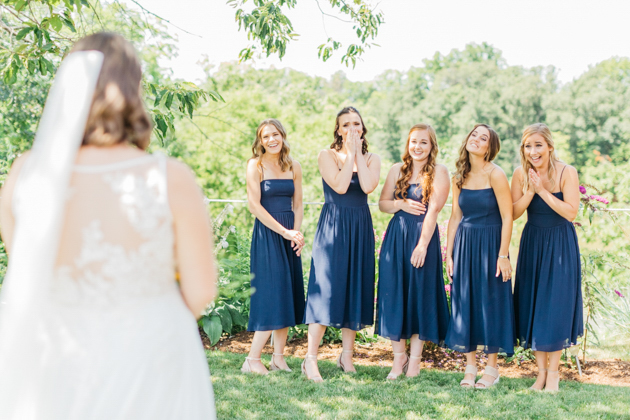 First look with bridesmaids at Stonewall Estates
