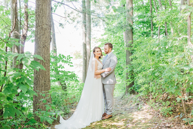 Bride and groom in forest at Stonewall Estates