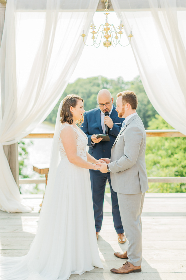 Bride and groom during ceremony at Stonewall Estates
