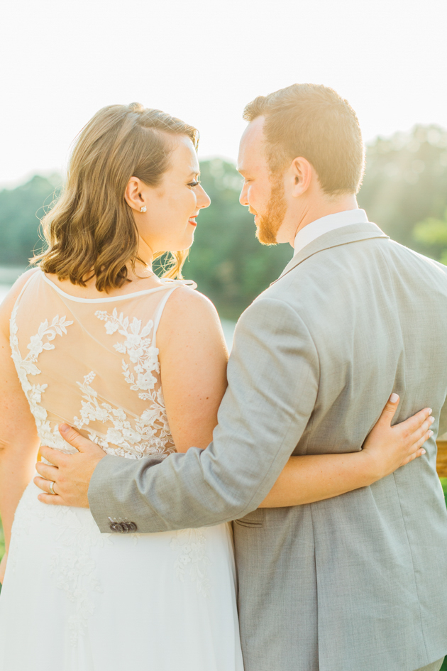 Bride and groom embracing during sunset
