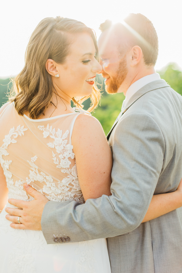 Bride and groom hugging during sunset at Stonewall Estates