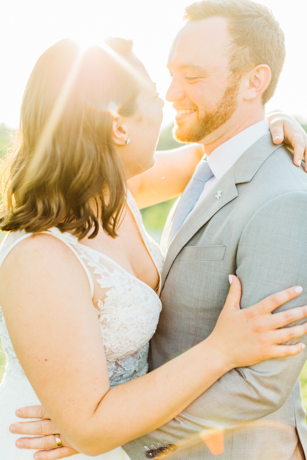 Bride and groom laughing during sunset at Stonewall Estates